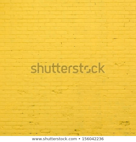 Background with old yellow painted brick wall Stock photo © H2O