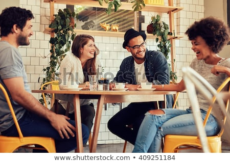 Group of friends having a drink together Stock photo © photography33