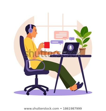 Man listening to his laptop on headphones Stock photo © photography33