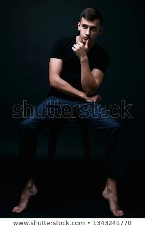 model posing on chear Stock photo © zastavkin