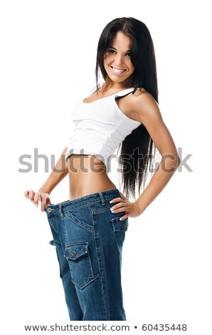 Girl demonstrating weight loss Stock photo © Nobilior