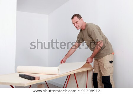 Decorator preparing to hang wallpaper Stock photo © photography33