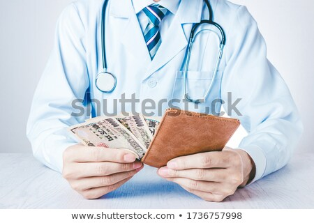 earned money for medical treatment and food Stock photo © OleksandrO