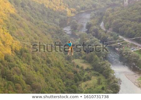 man slacklining over river stock photo © pancaketom