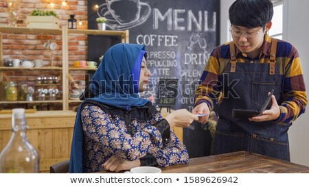 Male waiter holding credit-card and receipt Stock photo © photography33