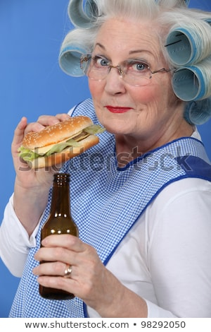 Old woman in rollers with a burger and a beer Stock photo © photography33