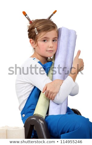 little girl wearing painter's overalls and holding wallpapers Stock photo © photography33