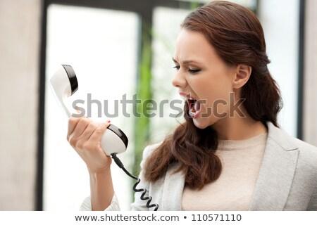 Mérges üzletasszony kiált telefon iroda mosoly Stock fotó © wavebreak_media