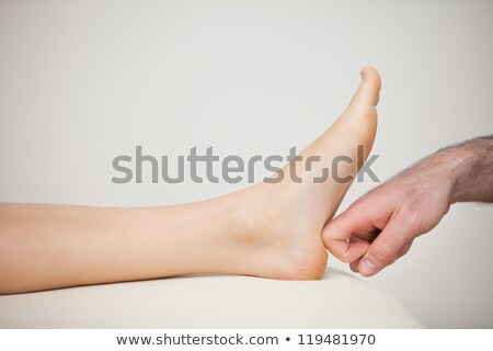 forefinger touching a barefoot in a room stock photo © wavebreak_media