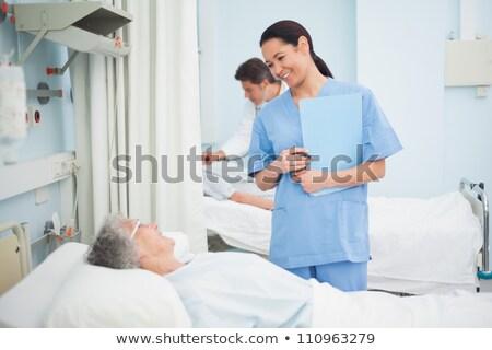 Nurse looking after a patient in hospital ward Stock photo © wavebreak_media