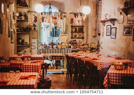 Ristorante italiano interni luce ristorante sedia rosso Foto d'archivio © luckyraccoon