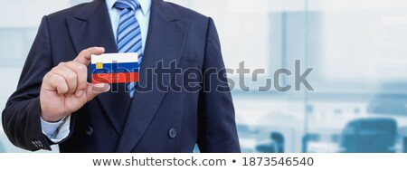 Russian Businessman holding business card with Russia Flag Stock photo © stevanovicigor