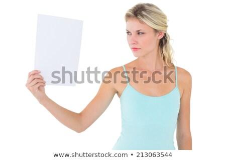 Stern blonde woman holding sheet of paper  Stock photo © wavebreak_media