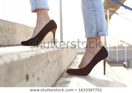 Walking up stairs in high heel stilettos Stock photo © roboriginal