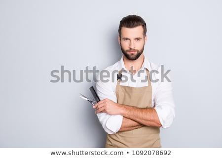 Handsome hair stylist holding scissors stock photo © wavebreak_media