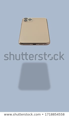 Man Showing a Hovering Smartphone Stock photo © kentoh