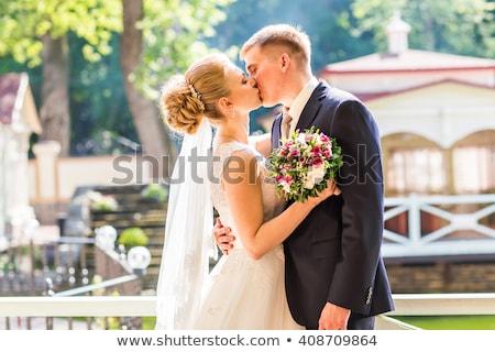 fiance kisses bride outdoor Stock photo © Paha_L
