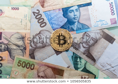 Banknote and coins of  Rupiah  of Indonesia Stock photo © CaptureLight