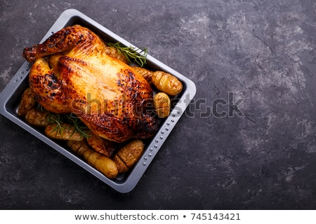 Roast chicken and potatoes stock photo © Digifoodstock