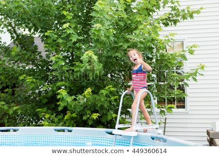 Happy five year old girl entering swimming pool Stock photo © ozgur