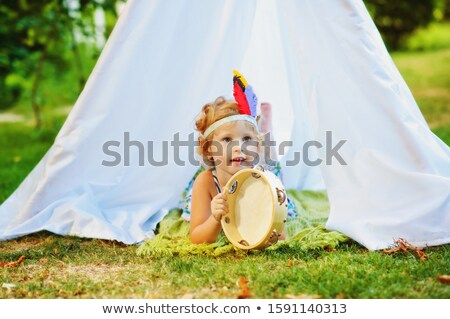 Little girl in native indian costume Stock photo © bluering