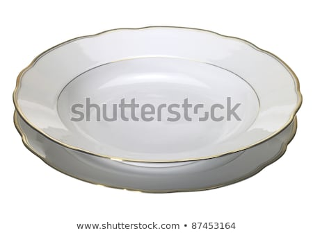 Two rimmed plates Stock photo © Digifoodstock