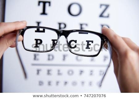 Közelkép látásvizsgálat szemüveg fehér háttér fekete Stock fotó © Hochwander