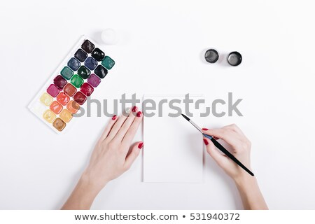 top view palette of watercolor paints brushes and paper for a w stock photo © yatsenko