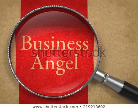 Business Angel through Loupe on Old Paper. Stock photo © tashatuvango