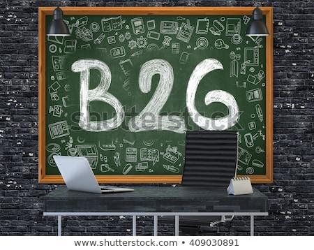 b2g concept doodle icons on chalkboard stock photo © tashatuvango
