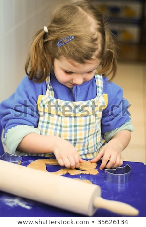 young girl cutting cookies Stock photo © IS2