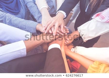 Asian businessmen in business suits handshaking Stock photo © studioworkstock