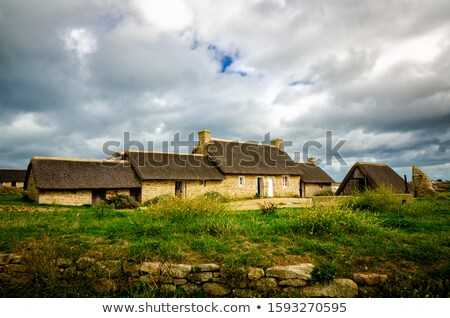 Cottage between the rocks. Brittany, France Stock photo © macsim