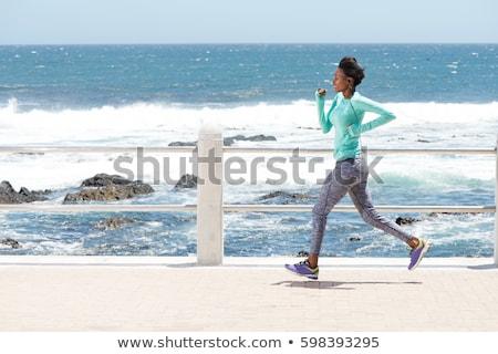 mutlu · kadın · çalışma · deniz · plaj · kız - stok fotoğraf © neonshot