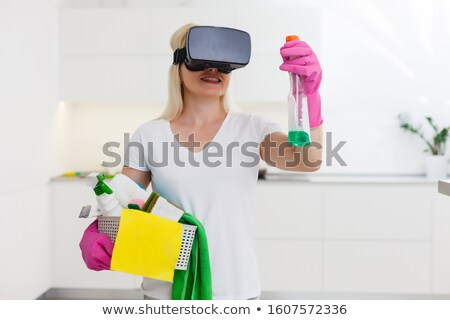 virtual reality goggle women_Housekeeping Stock photo © toyotoyo