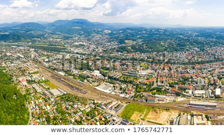 Graz city center and Mur river aerial view Stock photo © xbrchx