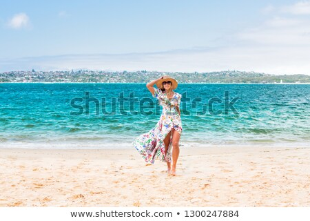Female walking along a secluded beach in Sydney Harbour Stock photo © lovleah