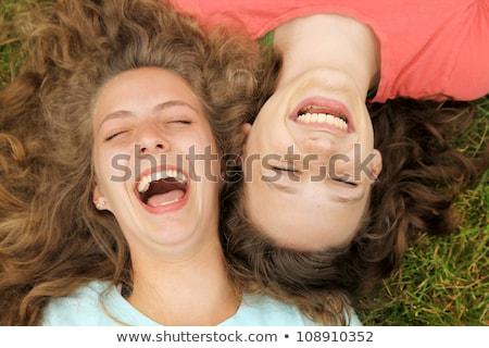 adolescente · Coppia · ridere · divertimento · femminile · sorridere - foto d'archivio © dolgachov