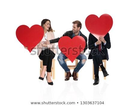 Sitzend Menschen halten groß rot Herzen Stock foto © feedough