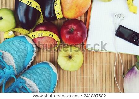 Fitnessz egészséges étel súlyzók granola ital üveg Stock fotó © karandaev