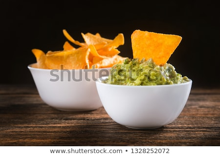 Bowl of guacamole on the wooden table Stock photo © Alex9500