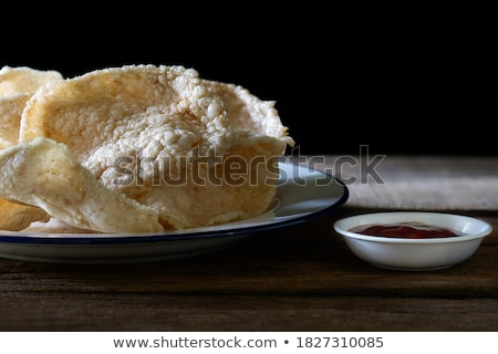 Crackers with salt and sauce on a wooden Stock photo © masay256