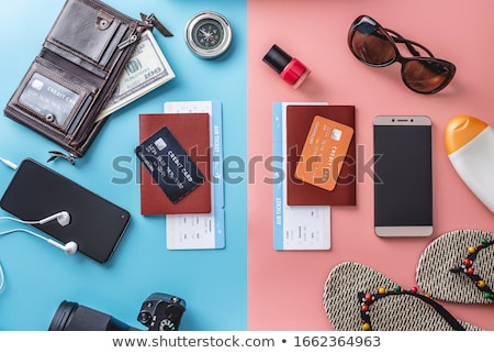 couple with air tickets, passport and money Stock photo © dolgachov