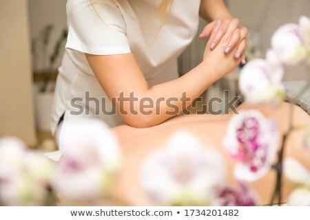 Femme coude massage Retour beauté spa Photo stock © boggy