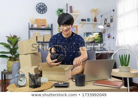 Young Asian man business owner working at home Start up for Busi Stock photo © snowing