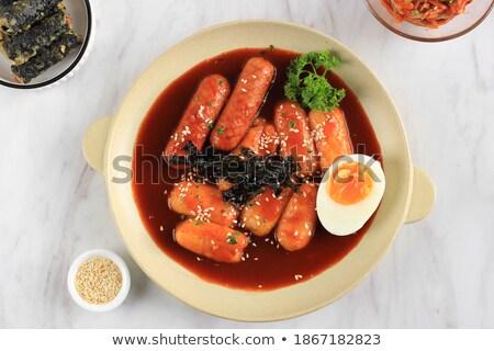 rustic korean spicy rice cake tteokbokki food background Stock photo © zkruger