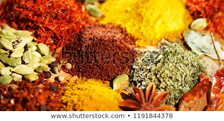 Turmeric curcuma powder and chili powder in spices market in India Stock photo © dmitry_rukhlenko