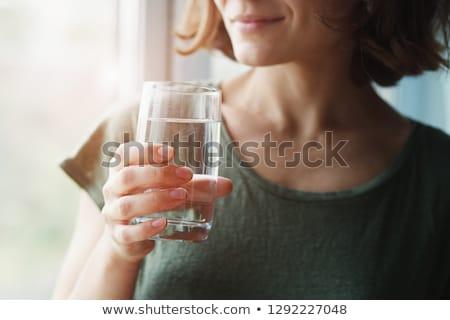kom · water · roze · witte · bloemen · spa - stockfoto © ivonnewierink