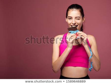 morder · chocolate · bastante · jovem · morena - foto stock © andreykr