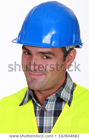 Close-up shot of a smiling tradesman Stock photo © photography33